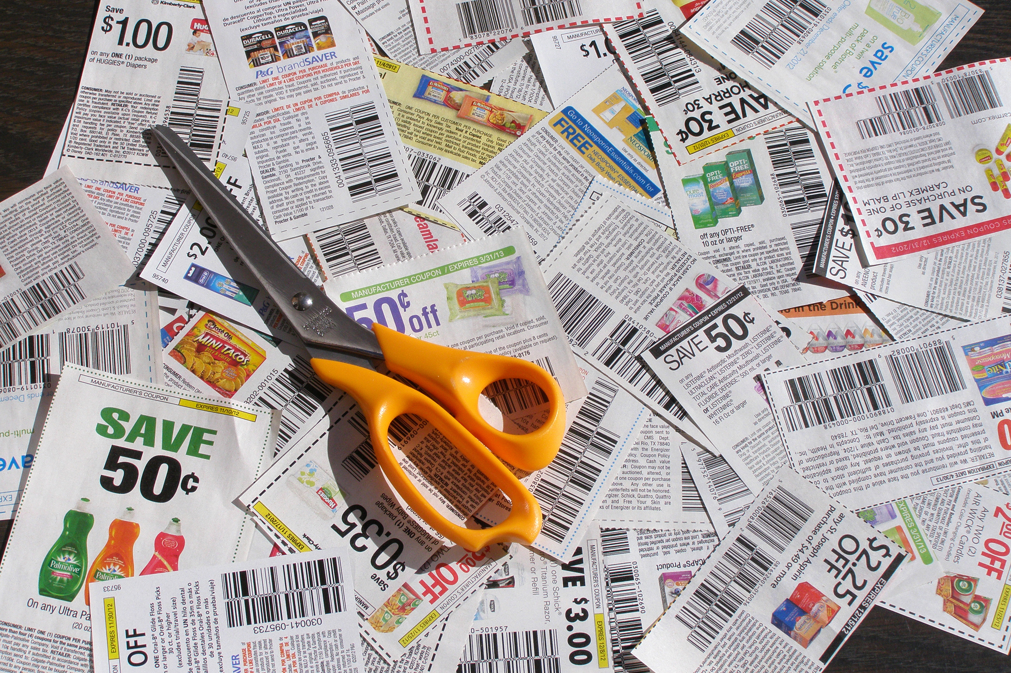 Clipping coupons with scissors